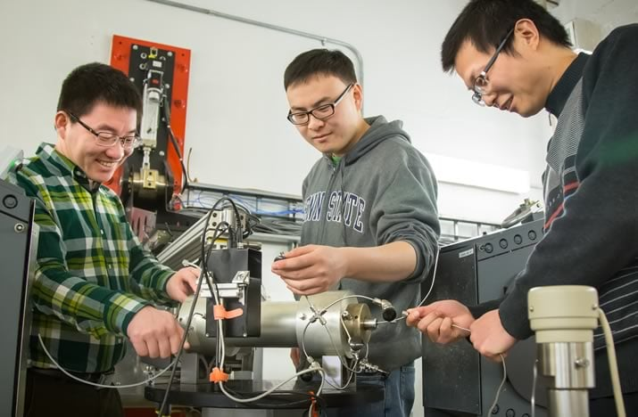 Shimin Liu and colleagues working in the lab.