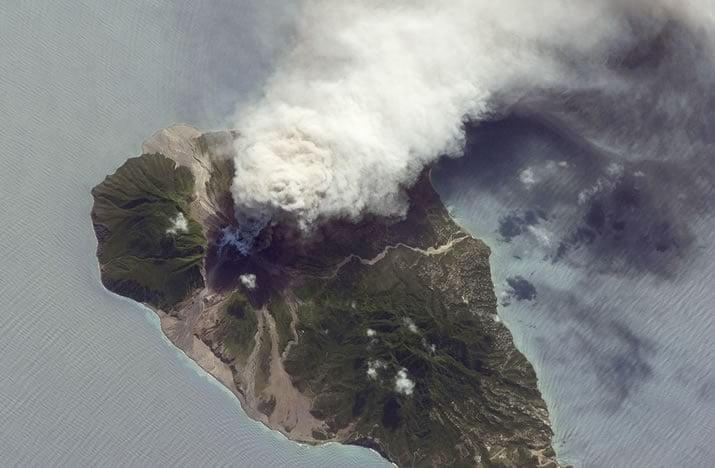 Aerial photograph of a smoke plume emanating from the Soufriere Hills Volcano.